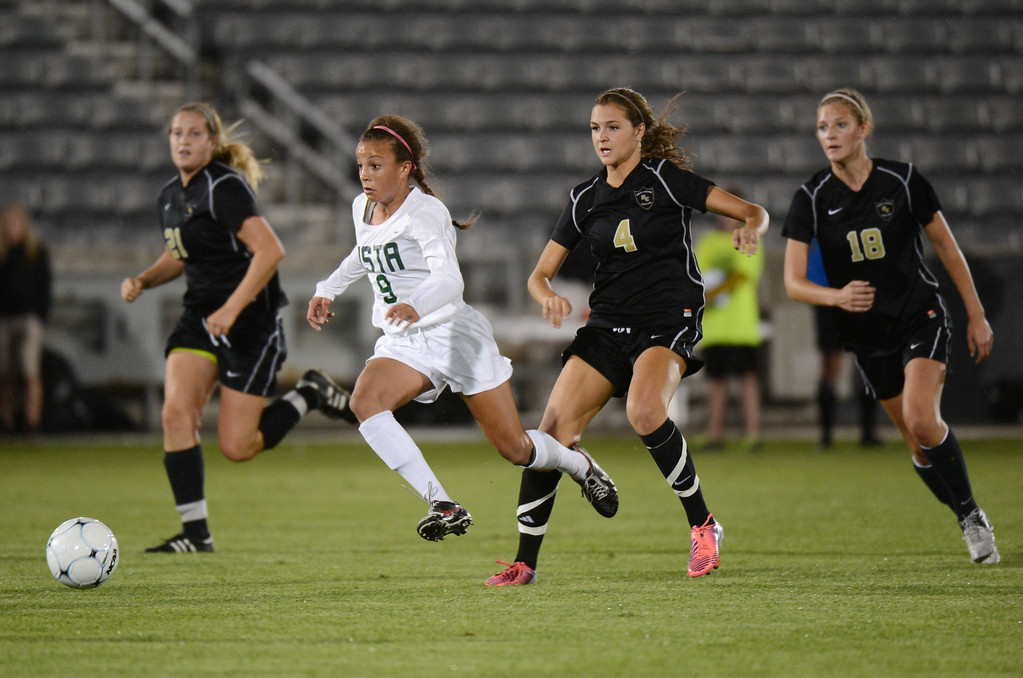 . Mallory Pugh of Mountain Vista High School (9) controls the ball against Morgan Storch (21), Allie Riggs (4) and Emily Postman (18) of Rock Canyon High School during the 5A girls soccer championship game. (Photo By Hyoung Chang/The Denver Post)