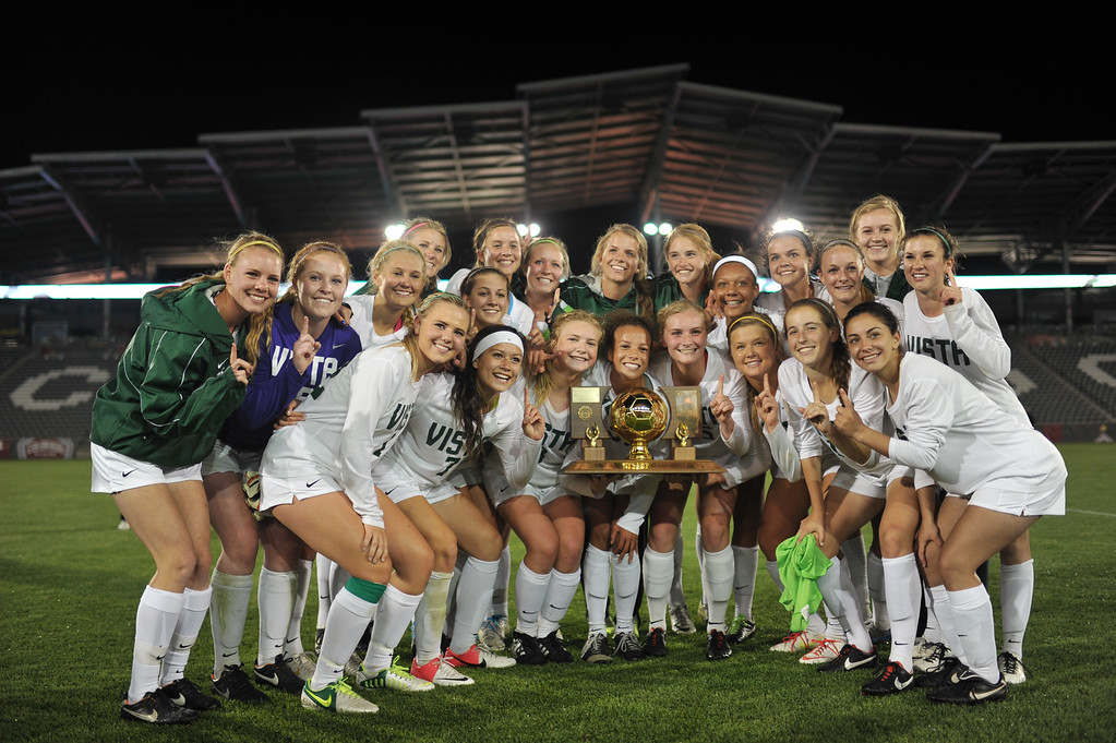 . Mountain Vista High School players celebrate their 1-0 overtime win in the 5A girls soccer championship game against Rock Canyon High School. (Photo By Hyoung Chang/The Denver Post)