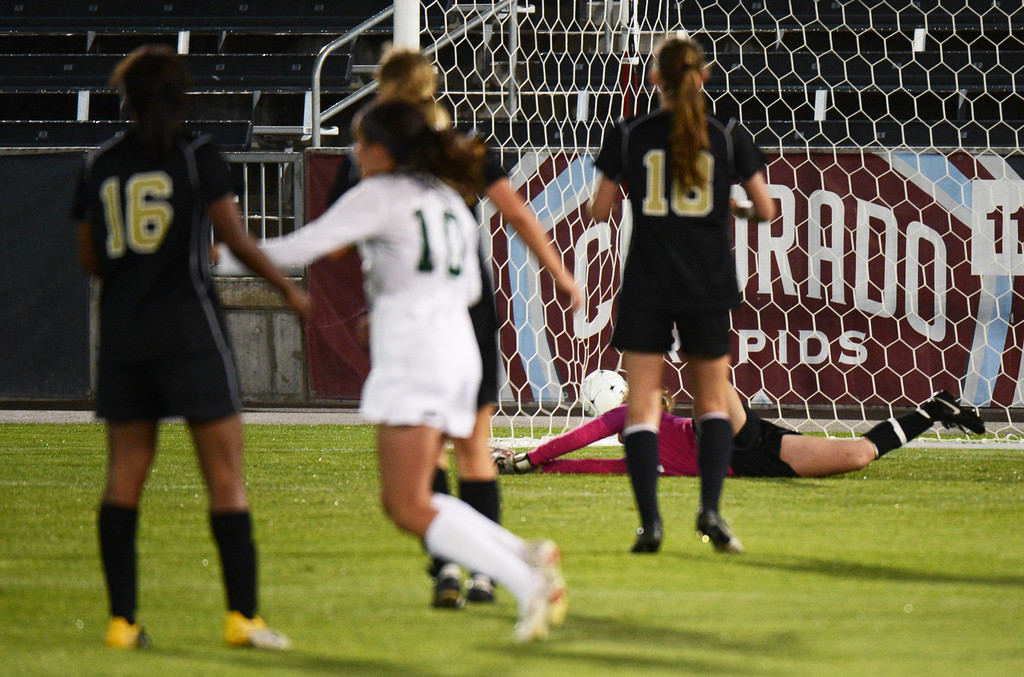 . Megan Massey of Mountain Vista High School\'s (10) scored the winning goal on Julia Henning of Rock Canyon High School (1) in the overtime of the 5A girls soccer championship game at Dick\'s Sporting Goods Park on Wednesday, May 22, 2013. (Photo By Hyoung Chang/The Denver Post)