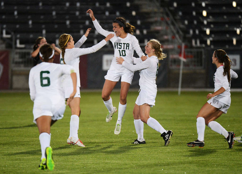 . Megan Massey of Mountain Vista High School (10) celebrates her winning goal with her teammates in the 5A girls soccer championship game against Rock Canyon High School at Dick\'s Sporting Goods Park in Commerce City, Colorado on Wednesday, May 22, 2013. Mountain Vista won 1-0 in overtime. (Photo By Hyoung Chang/The Denver Post)