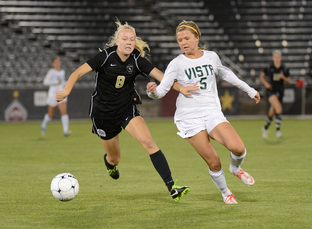 . Amy Alexander of Mountain Vista High School (5) and Makayla McBride of Rock Canyon High School (8) chase the ball during the 5A girls soccer championship game at Dick\'s Sporting Goods Park in Commerce City, Colorado, on Wednesday, May 22, 2013. (Photo By Hyoung Chang/The Denver Post)