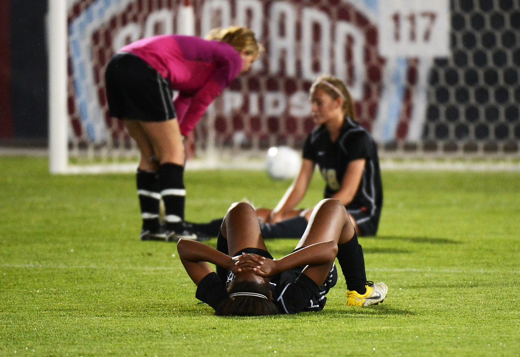 . Erin Webb of Rock Canyon High School (16) reacts to the team\'s overtime loss to Mountain Vista High School in the 5A girls soccer championship game. Mountain Vista won, 1-0. (Photo By Hyoung Chang/The Denver Post)