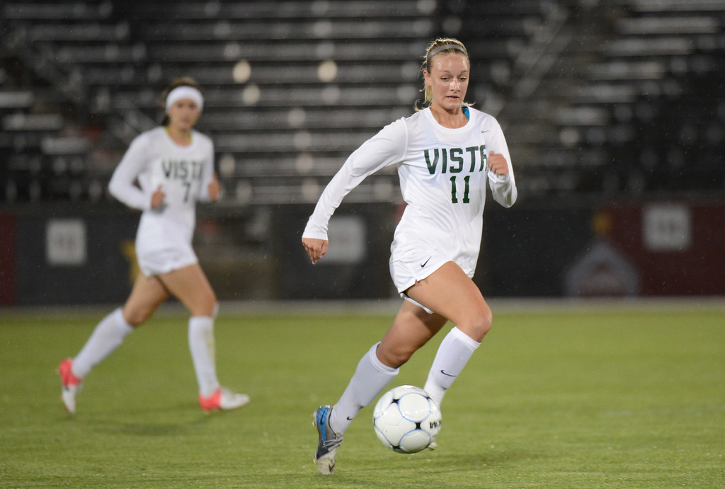 . Jenn Shelton of Mountain Vista High School (11) brings the ball down the field during the 5A girls soccer championship game against Rock Canyon High School. (Photo By Hyoung Chang/The Denver Post)