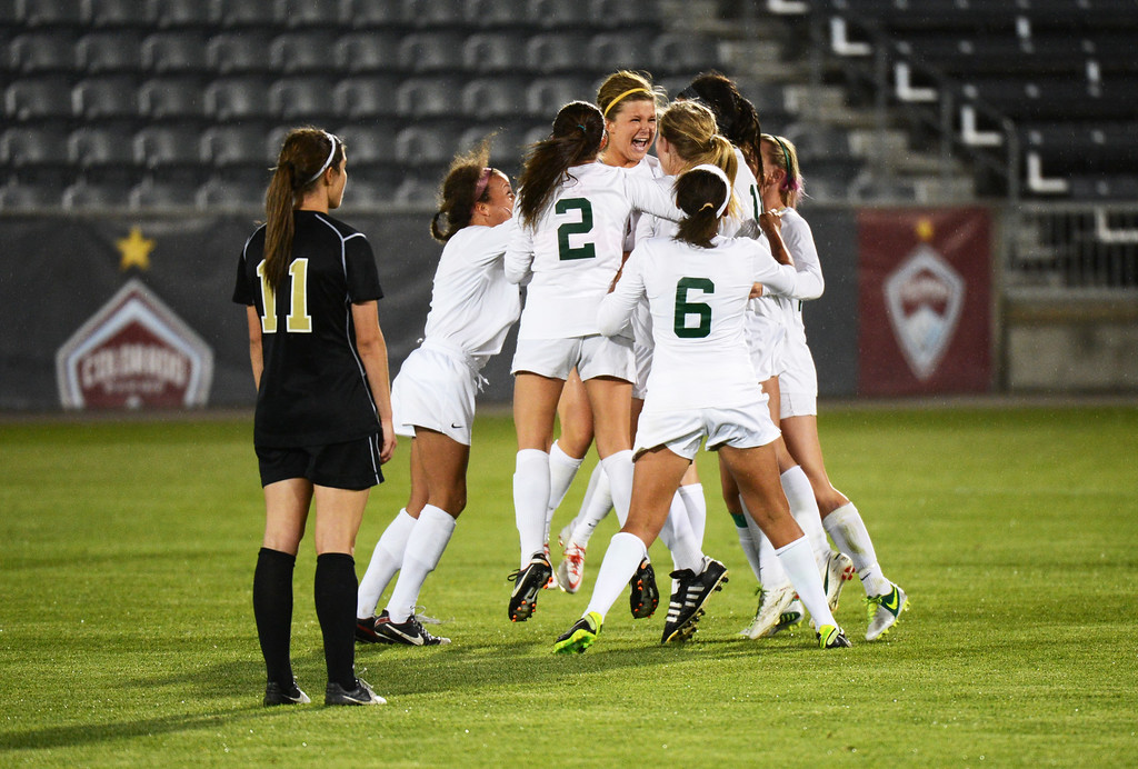 . Mountain Vista High School Players celebrateMegan Massey\'s winning goal against Rock Canyon High School (11) in the 5A girls soccer championship game. Photo By Hyoung Chang/The Denver Post)