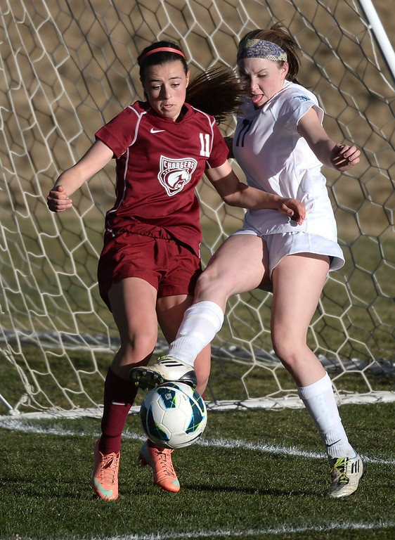 . ARVADA, CO - MARCH 19: Chatfield junior midfielder Dixie Lutz, left, stopped Ralston Valley senior forward Janelle Felmann, right, in the second half. The Ralston Valley High School girl\'s soccer team defeated Chatfield 3-2 with an overtime goal by sophomore forward Emma Musson Wednesday evening, March 19, 2014. (Photo by Karl Gehring/The Denver Post)