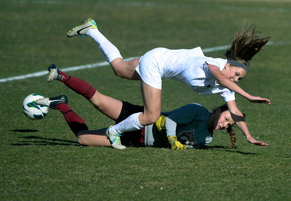 . ARVADA, CO - MARCH 19: Ralston Valley forward Alaina Sneddan, top, crashed into Chatfield goalie Brittany Wilson, bottom, in the first half. The Ralston Valley High School girl\'s soccer team defeated Chatfield 3-2 with an overtime goal by sophomore forward Emma Musson Wednesday evening, March 19, 2014. (Photo by Karl Gehring/The Denver Post)