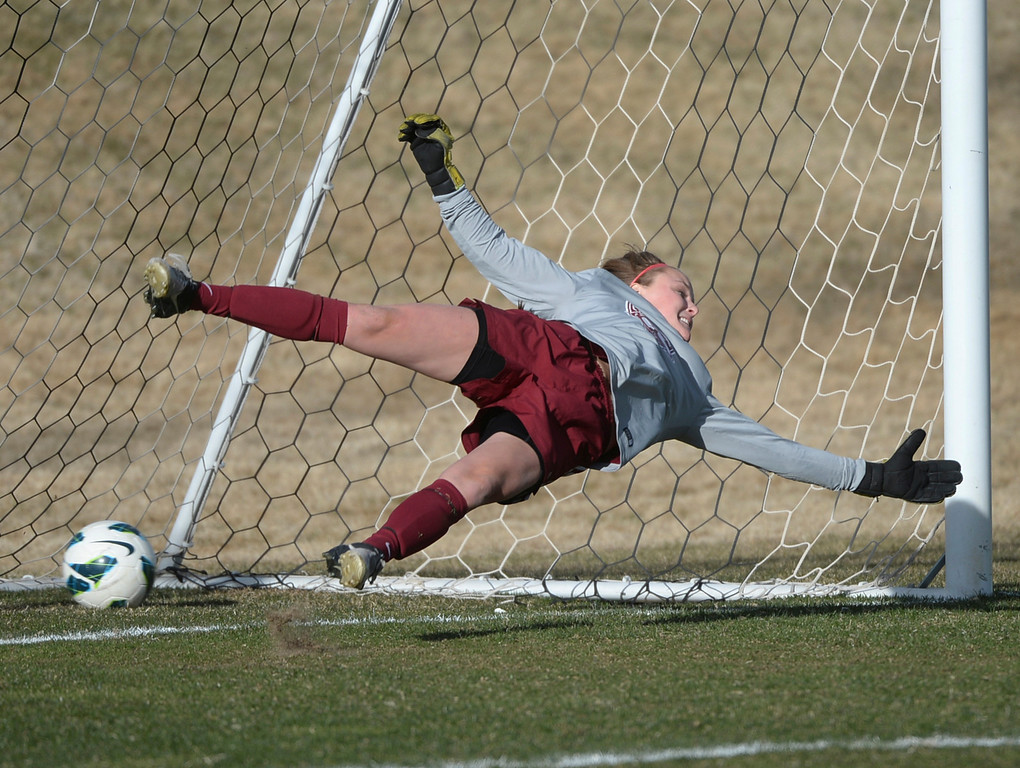 . ARVADA, CO - MARCH 19: Chatfield goalie Brittany Wilson made a diving attempt to stop a penalty shot off the foot of Ralston Valley\'s Alyssa Kaiser in the second half. The Ralston Valley High School girl\'s soccer team defeated Chatfield 3-2 with an overtime goal by sophomore forward Emma Musson Wednesday evening, March 19, 2014. (Photo by Karl Gehring/The Denver Post)