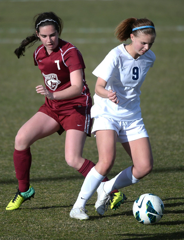 . ARVADA, CO - MARCH 19: Ralston Valley forward Emma Musson (9) raced past Chatfield\'s analia Quirk (7) in the second half. The Ralston Valley High School girl\'s soccer team defeated Chatfield 3-2 with an overtime goal by sophomore forward Emma Musson Wednesday evening, March 19, 2014. (Photo by Karl Gehring/The Denver Post)
