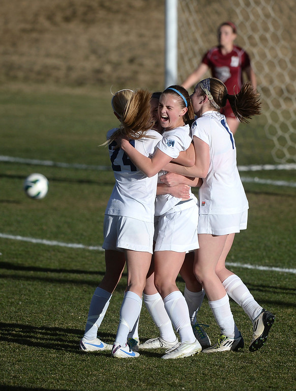 . ARVADA, CO - MARCH 19: Ralston Valley players mobbed sophomore forward Emma Musson after she scored the winning goal with two second remaining in the second overtime period Wednesday. The Ralston Valley High School girl\'s soccer team defeated Chatfield 3-2 Wednesday evening, March 19, 2014. (Photo by Karl Gehring/The Denver Post)