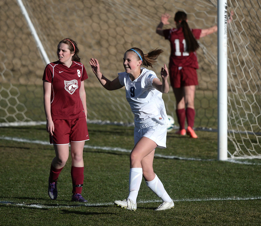 . ARVADA, CO - MARCH 19: Sophomore forward Emma Musson looked to her teammates after she scored the winning goal with two second remaining in the second overtime period Wednesday. The Ralston Valley High School girl\'s soccer team defeated Chatfield 3-2 Wednesday evening, March 19, 2014. (Photo by Karl Gehring/The Denver Post)