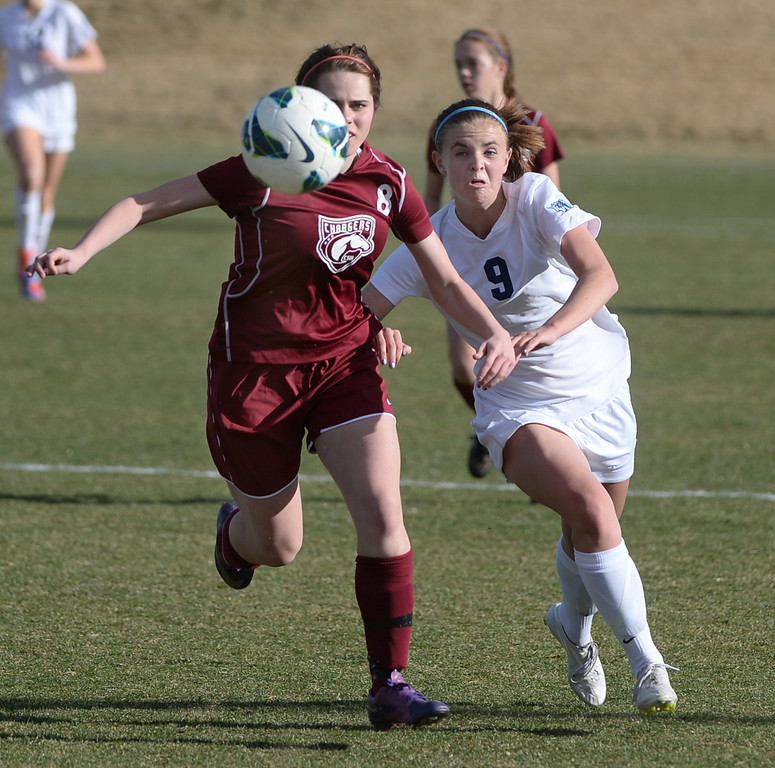 . ARVADA, CO - MARCH 19: Chatfield defenseman Elena Gossen (8) challenged Ralston Valley forward Emma Musson (9) for the ball in the second half. The Ralston Valley High School girl\'s soccer team defeated Chatfield 3-2 with an overtime goal by sophomore forward Emma Musson Wednesday evening, March 19, 2014. (Photo by Karl Gehring/The Denver Post)