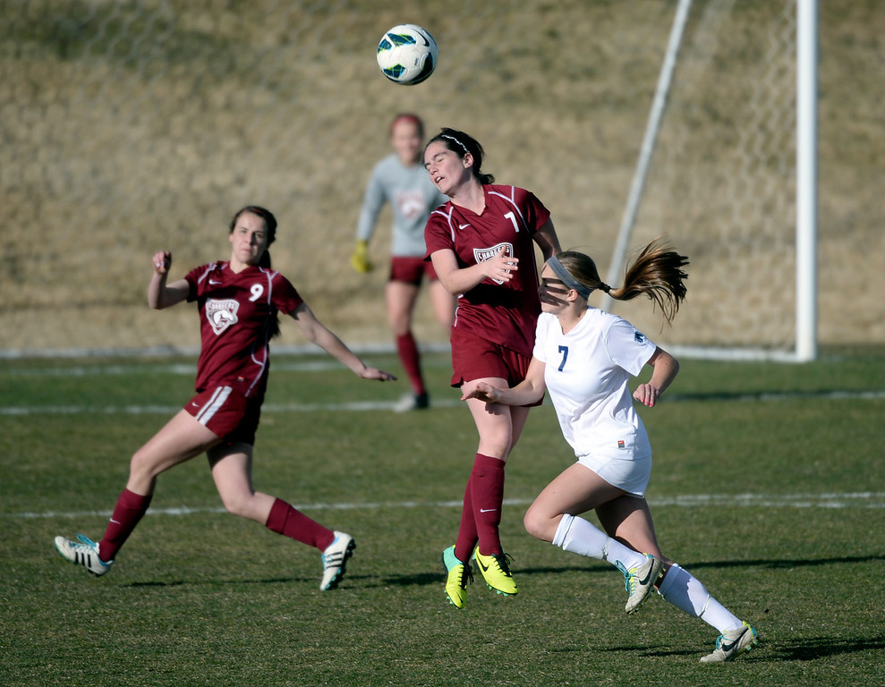 . ARVADA, CO - MARCH 19: Chatfield midfielder Analia Quirk (7) cleared the ball with a header in the first half. The Ralston Valley High School girl\'s soccer team defeated Chatfield 3-2 with an overtime goal by sophomore forward Emma Musson Wednesday evening, March 19, 2014. (Photo by Karl Gehring/The Denver Post)