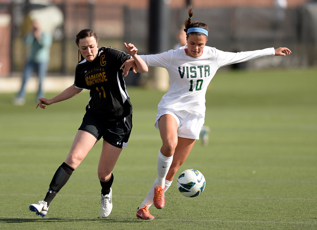 . Megan Massey of Mountain Vista High School (10) controls the ball against Amanda Cadoretie of Arapahoe High School (11) in the first half of the game at Shea Stadium in Highlands Ranch, Colorado on March 29, 2014. Mountain Vista won, 5-4. (Photo by Hyoung Chang/The Denver Post)