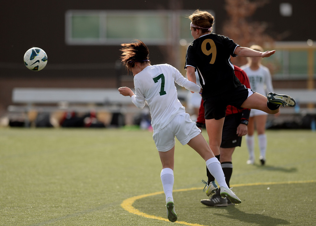 . Sarah Netherton of Mountain Vista High School (7) and Kelsey Vogel of Arapahoe High School (9) fight for a free ball in the second half of the game at Shea Stadium in Highlands Ranch, Colorado on March 29, 2014. Mountain Vista won, 5-4. (Photo by Hyoung Chang/The Denver Post)