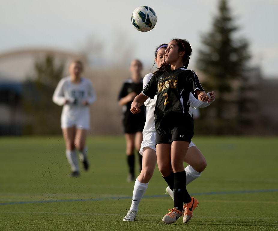 . Elena Jauregui of Arapahoe High School (2) is in action during the second half of the game at Shea Stadium in Highlands Ranch, Colorado on March 29, 2014. Mountain Vista won, 5-4. (Photo by Hyoung Chang/The Denver Post)