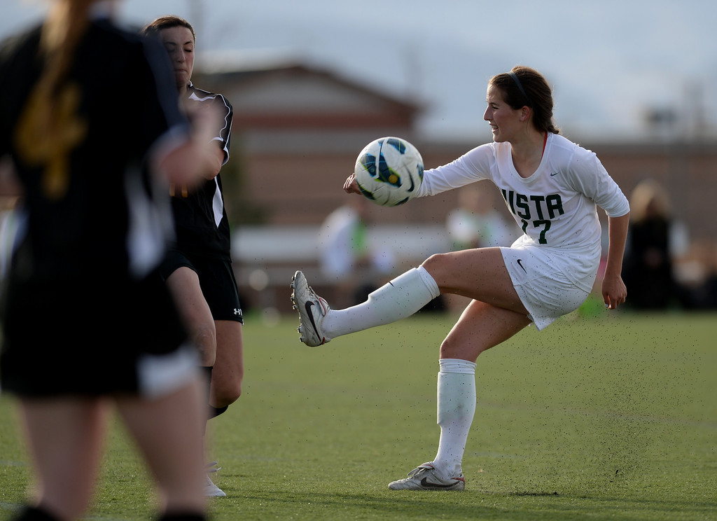 . Morgan McDougal of Mountain Vista High School (17) is in action during the second half of the game against Arapahoe High School at Shea Stadium in Highlands Ranch, Colorado on March 29, 2014. Mountain Vista won, 5-4. (Photo by Hyoung Chang/The Denver Post)