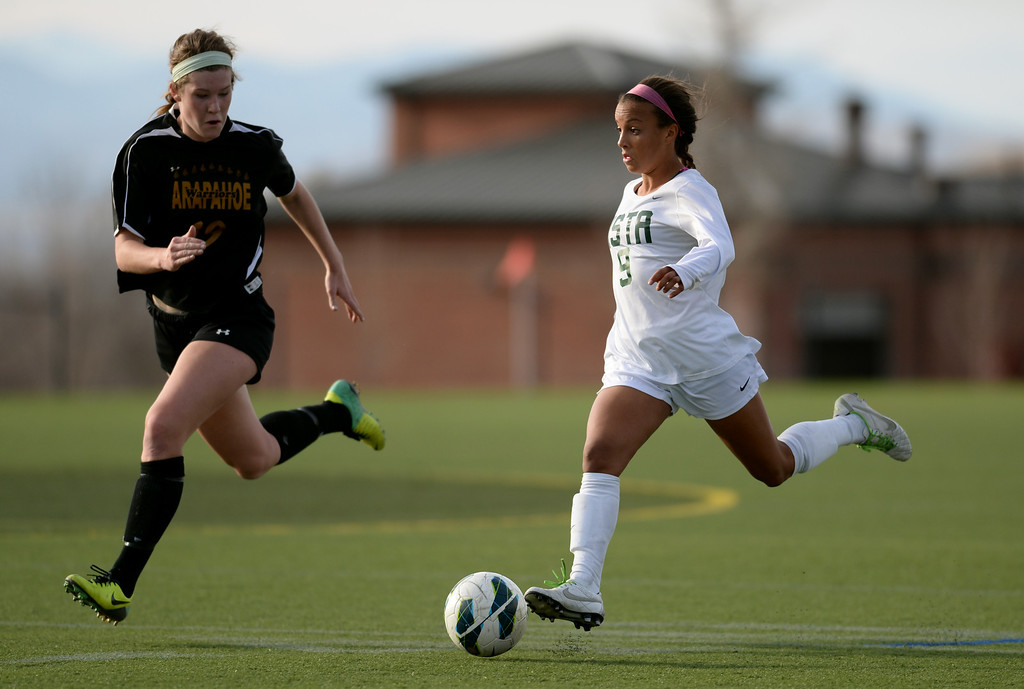 . Mallory Pugh of Mountain Vista High School (9), controls the ball against Jacqueline Pepper of Arapahoe High School (10) in the second half of the game at Shea Stadium in Highlands Ranch, Colorado on March 29, 2014. Mountain Vista won, 5-4. (Photo by Hyoung Chang/The Denver Post)