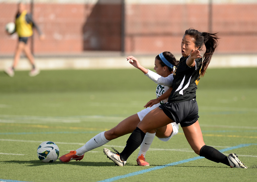 . Kai-Bin Ool of Arapahoe High School (8), right, pressures Megan Massey of Mountain Vista High School (10) in the first half of the game at Shea Stadium in Highlands Ranch, Colorado on March 29, 2014. Mountain Vista won, 5-4. (Photo by Hyoung Chang/The Denver Post)