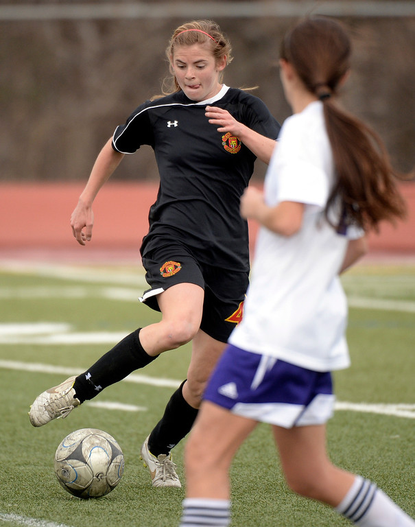 . Castle View forward Julie Mackin (4) dribbled through traffic in overtime. The Littleton High School girl\'s soccer team played Castle View to a scoreless tie Tuesday afternoon, April 1 in Littleton.  (Photo by Karl Gehring/The Denver Post)