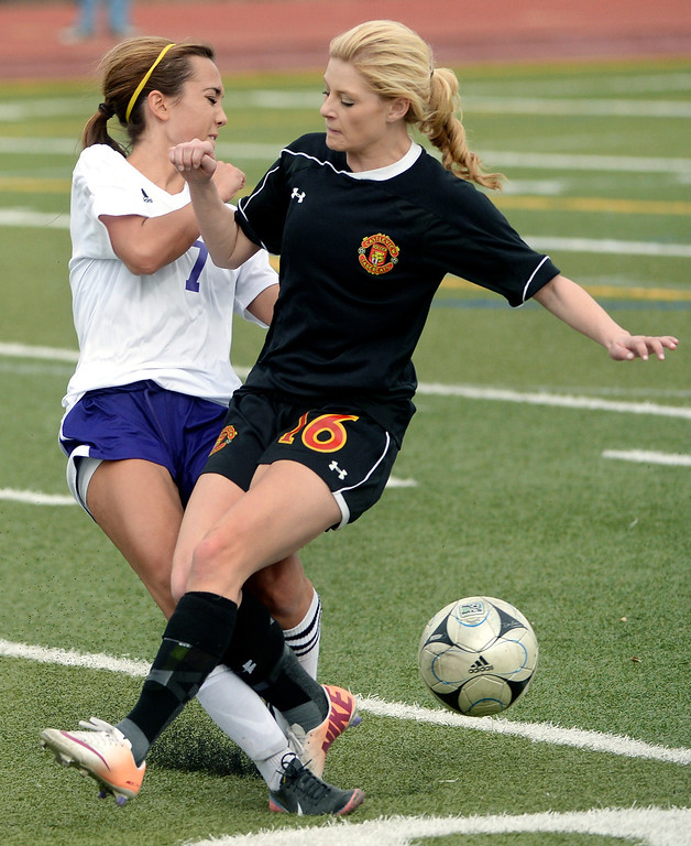 . Littleton midfielder Julie Stauffer (7) collided with Castle View forward Erynn Hargrave (16) as they went for the ball in the first half. The Littleton High School girl\'s soccer team played Castle View to a scoreless tie Tuesday afternoon, April 1 in Littleton.  (Photo by Karl Gehring/The Denver Post)