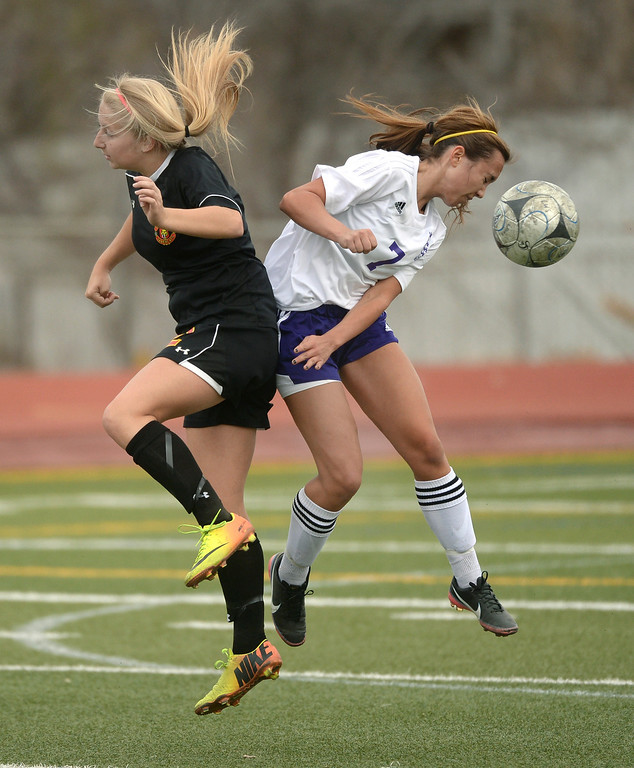 . Castle View defender Kim Bourelle (2) and Littleton midfielder Julie Stauffer (7) both went for a header in the first half. The Littleton High School girl\'s soccer team played Castle View to a scoreless tie Tuesday afternoon, April 1 in Littleton.  (Photo by Karl Gehring/The Denver Post)