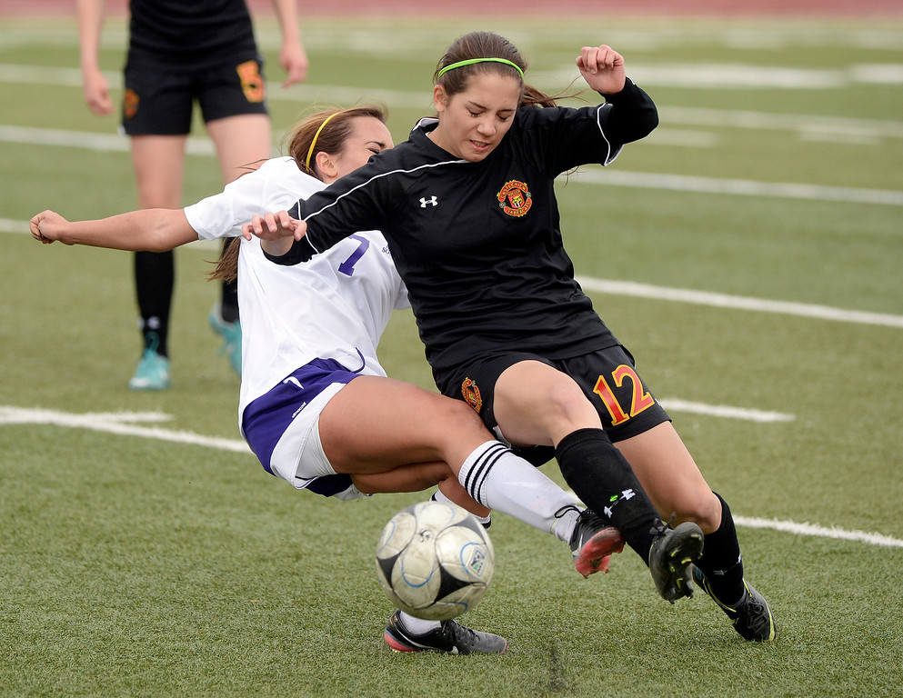 . Littleton senior midfielder Julie Stauffer (7) battled for the ball with Castle View midfielder Lindsay Iannone (12) in overtime. The Littleton High School girl\'s soccer team played Castle View to a scoreless tie Tuesday afternoon, April 1 in Littleton.  (Photo by Karl Gehring/The Denver Post)