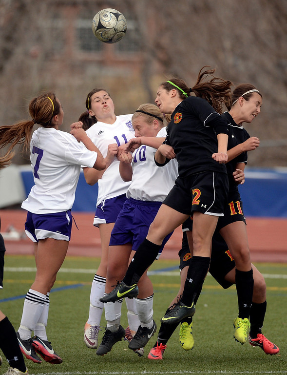 . Castle View midfielder Lindsay Iannone (12) tried head a shot towards the net on a second half corner kick. The Littleton High School girl\'s soccer team played Castle View to a scoreless tie Tuesday afternoon, April 1 in Littleton.  (Photo by Karl Gehring/The Denver Post)