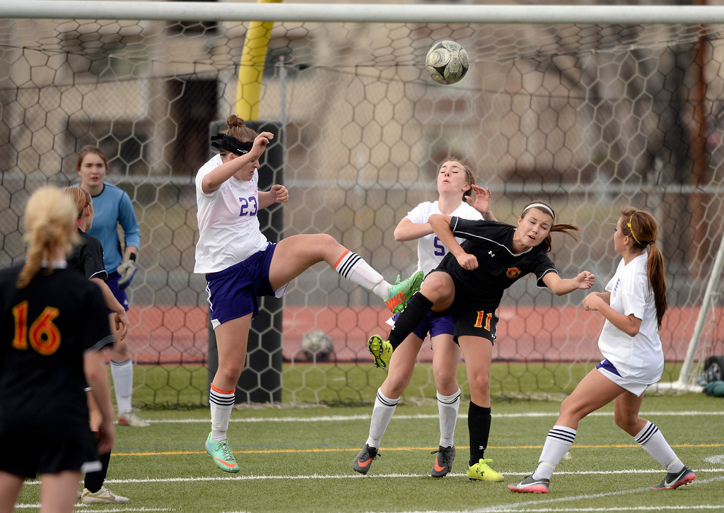 . Littleton defender Taylor Hancock (230 cleared the ball away from Castle View forward Julie Plonsky (11) in overtime. The Littleton High School girl\'s soccer team played Castle View to a scoreless tie Tuesday afternoon, April 1 in Littleton.  (Photo by Karl Gehring/The Denver Post)