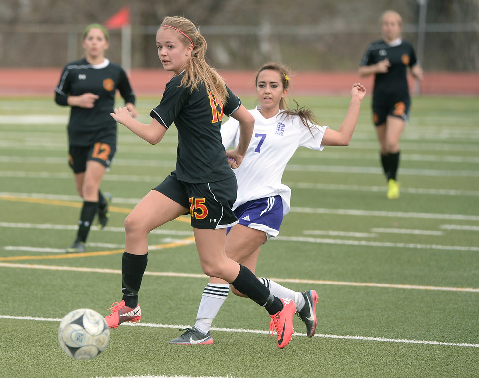 . Castle View forward Brandi Bain (15) and Littleton midfielder Julie Stauffer (7) followed the ball in the second half. The Littleton High School girl\'s soccer team played Castle View to a scoreless tie Tuesday afternoon, April 1 in Littleton.  (Photo by Karl Gehring/The Denver Post)