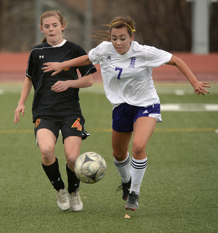 . Castle View forward Julie Mackin (4) and Littleton midfielder Julie Stauffer (7) chased the ball in the first half. The Littleton High School girl\'s soccer team played Castle View to a scoreless tie Tuesday afternoon, April 1 in Littleton.  (Photo by Karl Gehring/The Denver Post)