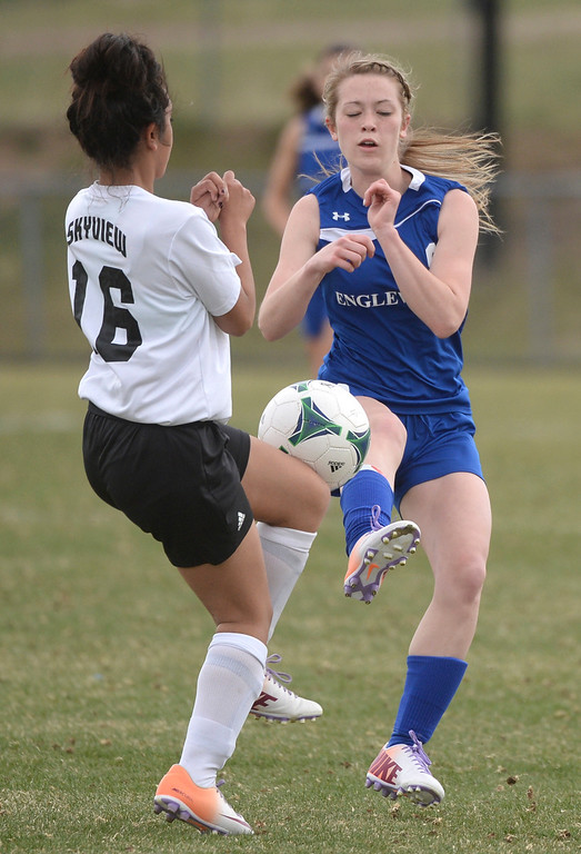 . THORNTON, CO - APRIL 10:  Skyview senior defender Mayra Galaviz (16) and Englewood midfielder Kadie Kavinsky (8) came to the ball in the first half. The Englewood High School girl\'s soccer team defeated Skyview 1-0 in a 4A matchup Thursday afternoon, April 10, 2014. (Photo by Karl Gehring/The Denver Post)