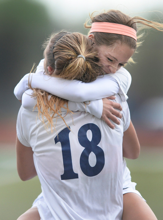. Allison Trizna embraced teammate Gabbi Fleischli (18) after her first half goal Wednesday night. The Valor Christian High School girl\'s soccer team defeated Pueblo West 4-1 Wednesday night, May 7, 2014 in the first round of the playoffs. (Photo by Karl Gehring/The Denver Post)