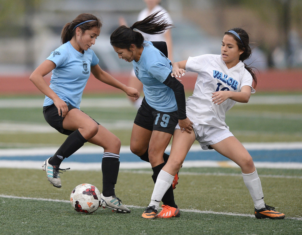 . Pueblo West teammates Deanna Rangel (7) and Riley Brodie (19) kept the ball from Valor sophomore midfielder Amanda Lopez (10) in the second half. The Valor Christian High School girl\'s soccer team defeated Pueblo West 4-1 Wednesday night, May 7, 2014 in the first round of the playoffs. (Photo by Karl Gehring/The Denver Post)