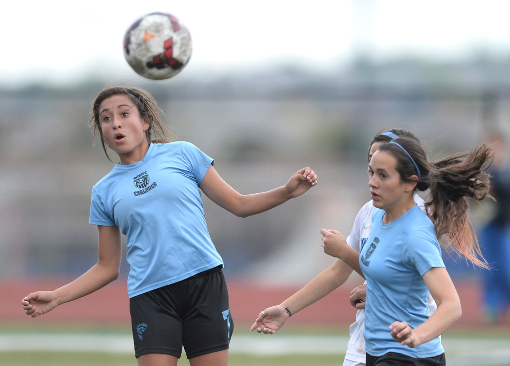 . HIGHLANDS RANCH, CO - MAY 7: Pueblo West junior midfielder Deanna Rangel (7) got her head on the ball in the first half.  The Valor Christian High School girl\'s soccer team defeated Pueblo West 4-1 Wednesday night, May 7, 2014 in the first round of the playoffs. (Photo by Karl Gehring/The Denver Post)