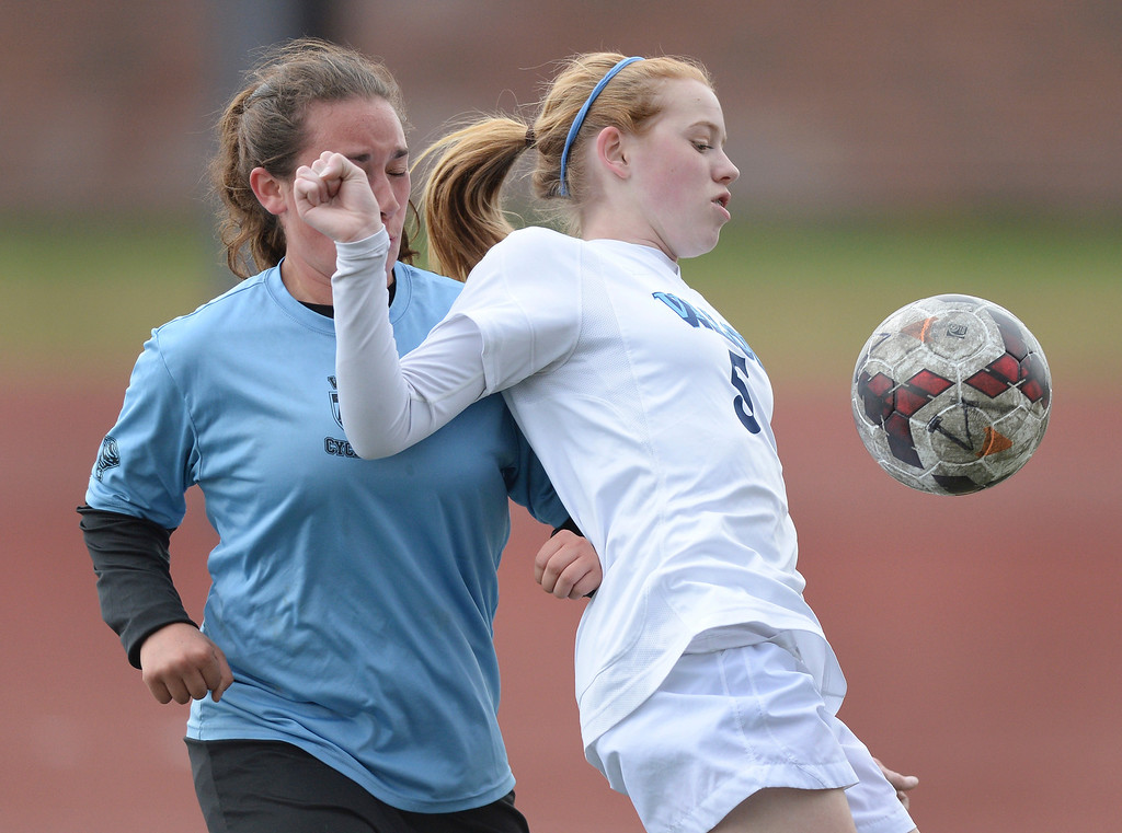 . Valor freshman midfielder Tess Boade (5) controlled the ball in front of Pueblo West defender Doria Perez (11) in the first half. The Valor Christian High School girl\'s soccer team defeated Pueblo West 4-1 Wednesday night, May 7, 2014 in the first round of the playoffs. (Photo by Karl Gehring/The Denver Post)