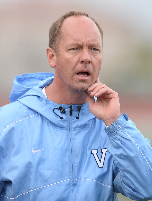 . Valor coach Dan Georgopulos asked a linesman about a call in the first half. The Valor Christian High School girl\'s soccer team defeated Pueblo West 4-1 Wednesday night, May 7, 2014 in the first round of the playoffs. (Photo by Karl Gehring/The Denver Post)