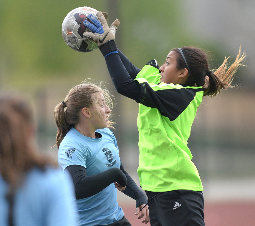 . Pueblo West goalie Brittany Guerrero made a save in the first half. The Valor Christian High School girl\'s soccer team defeated Pueblo West 4-1 Wednesday night, May 7, 2014 in the first round of the playoffs. (Photo by Karl Gehring/The Denver Post)