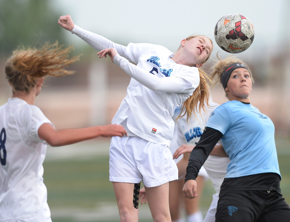 . Valor freshman midfielder Tess Boade (5) got her head on the ball in the first half. The Valor Christian High School girl\'s soccer team defeated Pueblo West 4-1 Wednesday night, May 7, 2014 in the first round of the playoffs. (Photo by Karl Gehring/The Denver Post)