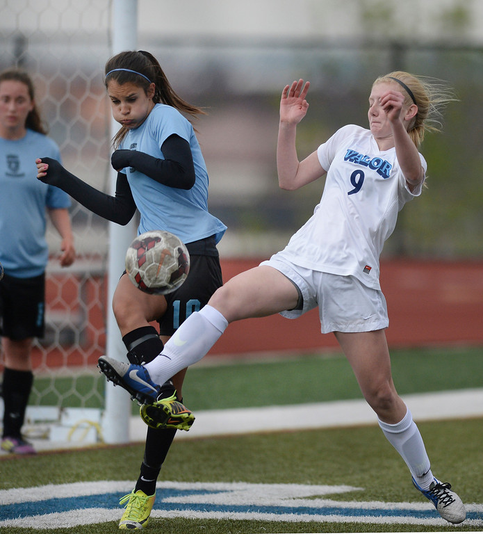 . Pueblo West senior defender Claire Fort (10) cleared the ball away from Valor freshman midfielder Paige Kula (9) on a corner kick in the second half. The Valor Christian High School girl\'s soccer team defeated Pueblo West 4-1 Wednesday night, May 7, 2014 in the first round of the playoffs. (Photo by Karl Gehring/The Denver Post)