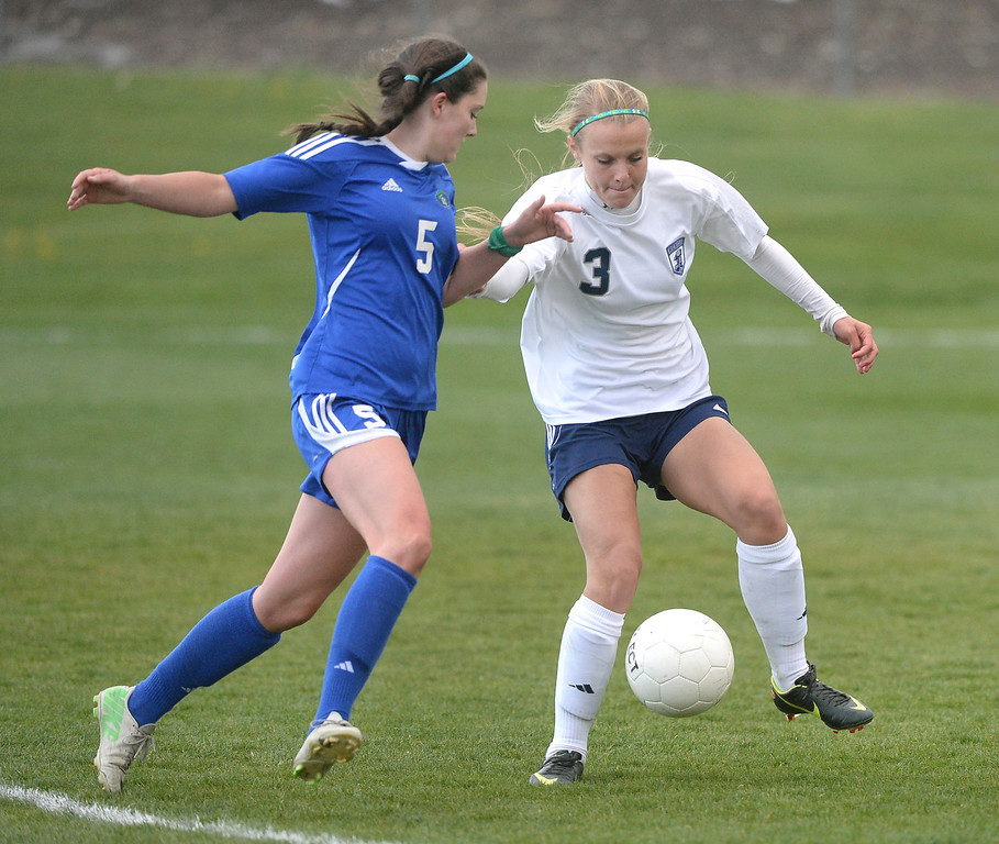 . Doherty midfielder Jordin Schaller (5) and Columbine senior Baylie Schmitz (3) battled for possession in the second half. The Columbine High School girl\'s soccer team defeated Doherty 3-1 in a 5A quarterfinal game Tuesday night, May 13, 2014. (Photo by Karl Gehring/The Denver Post)