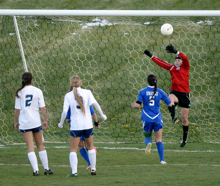 . Rebels\' goalkeeper Sarah Luebking (1) made a save as Spartans\' midfielder Jordin Schaller (5) looked for an opportunity in the second half.  (Photo by Karl Gehring/The Denver Post)