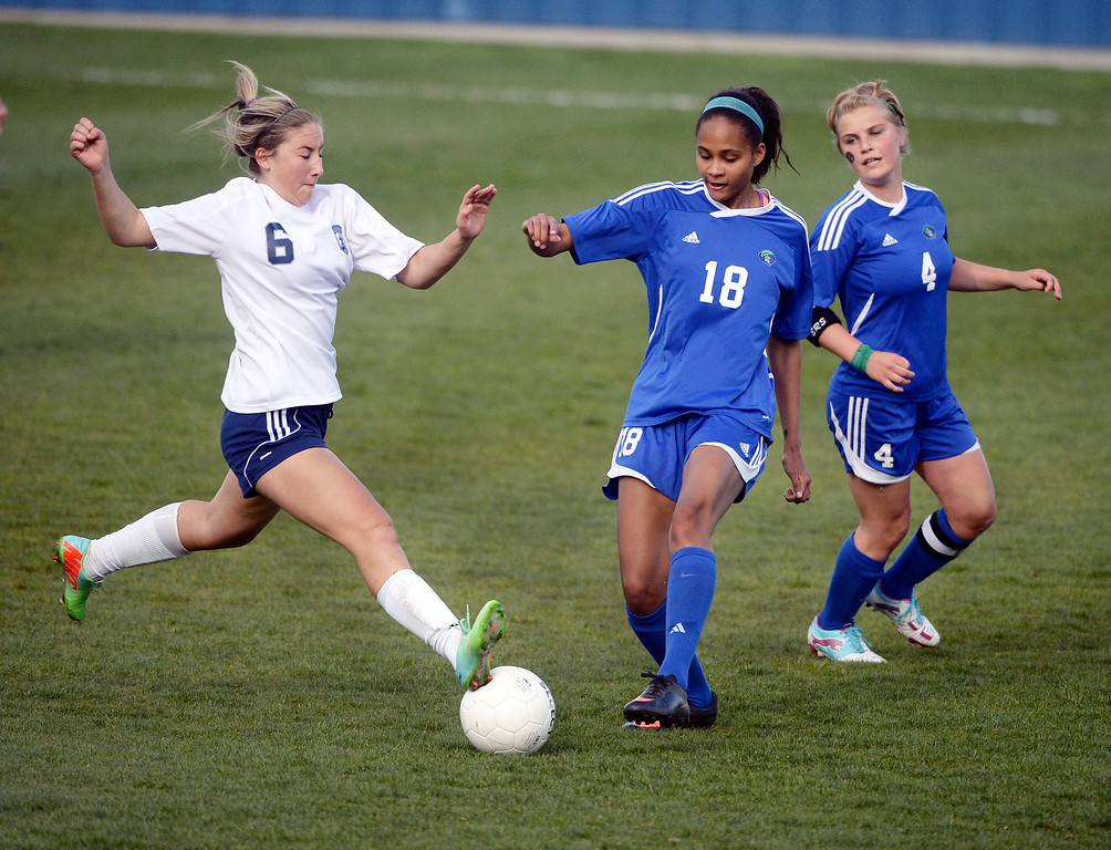 . Columbine forward Tatum Barton (6) worked against Doherty defenders Rianna Lockhart (18) and Alexis Charles (4) in the first half.  (Photo by Karl Gehring/The Denver Post)