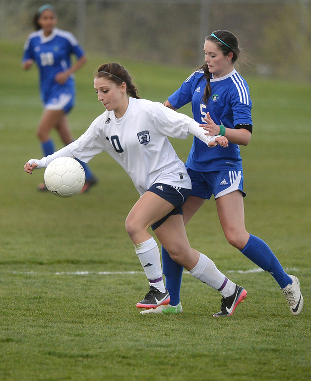 . Columbine senior forward Andonia Apergis (10) made a move past Doherty midfielder Jordin Schaller (5) in the second half.   (Photo by Karl Gehring/The Denver Post)