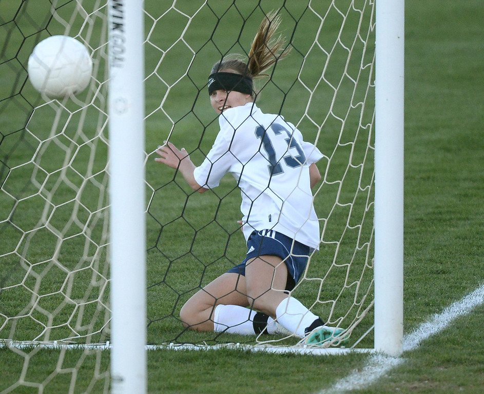 . Columbine forward Amanda Porter (13) put an insurance goal into the net late in the second half. The Columbine High School girl\'s soccer team defeated Doherty 3-1 in a 5A quarterfinal game Tuesday night, May 13, 2014. (Photo by Karl Gehring/The Denver Post)