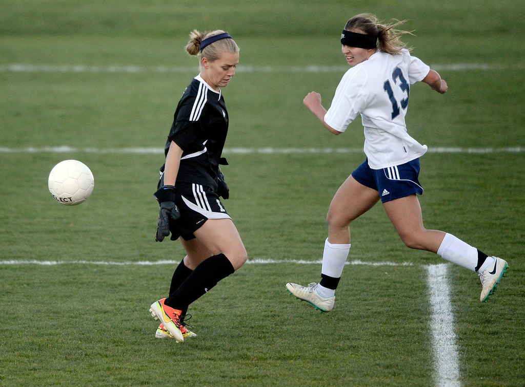 . Columbine forward Amanda Porter (13) made a move around Doherty goalie riley Furbush (1) for a goal late in the second half.  (Photo by Karl Gehring/The Denver Post)