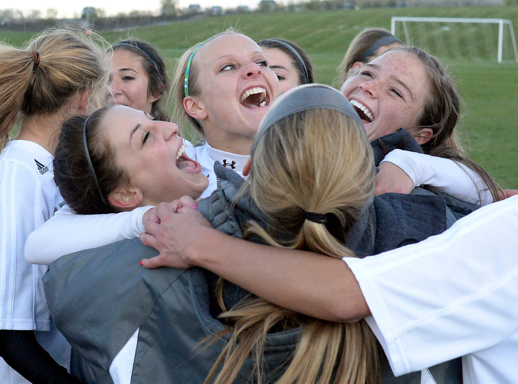 . The Rebels enjoyed the victory Tuesday night. The Columbine High School girl\'s soccer team defeated Doherty 3-1 in a 5A quarterfinal game Tuesday night, May 13, 2014. (Photo by Karl Gehring/The Denver Post)