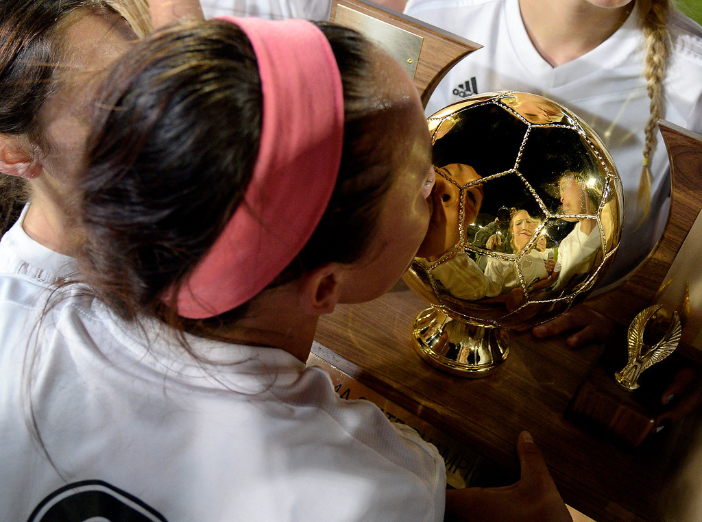 . Cheyenne Mountain Sara Walters (8) kisses the trophy as they celebrate their victory over Broomfield 2-0 for the  4A girls State Soccer Championship May 21, 2014 at Dick\'s Sporting Goods Park. (Photo by John Leyba/The Denver Post)