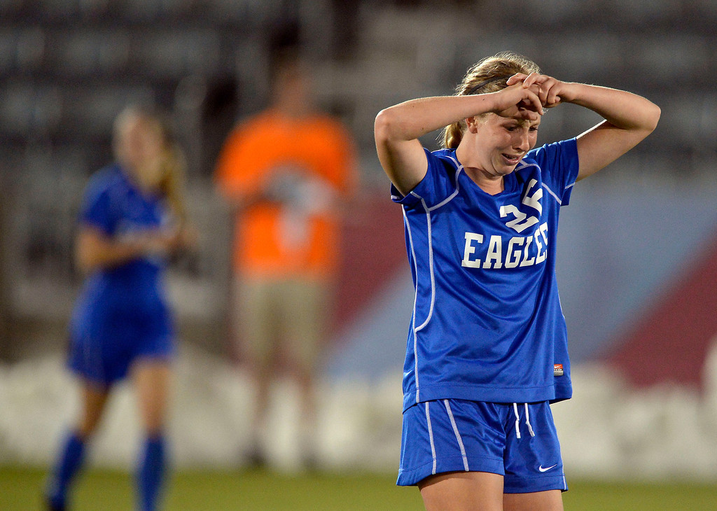 . Broomfield Michaela Stark (26) walks away crying after Cheyenne Mountain scored their second goal 1:55 left in the game of the 4A girls State Soccer Championship May 21, 2014 at Dick\'s Sporting Goods Park. Cheyenne Mountain defeated Broomfield 2-0. (Photo by John Leyba/The Denver Post)