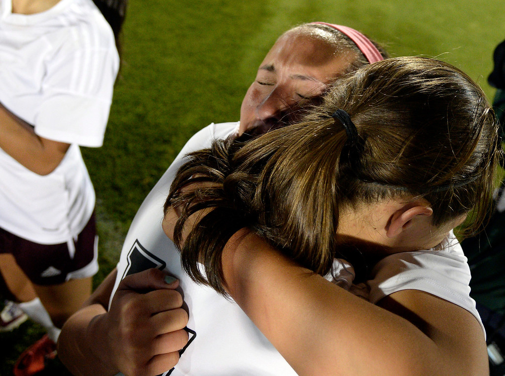 . Cheyenne Mountain Sara Walters (8) hugs Tori Burnett (11) as they celebrate their victory over Broomfield 2-0 for the  4A girls State Soccer Championship May 21, 2014 at Dick\'s Sporting Goods Park. (Photo by John Leyba/The Denver Post)
