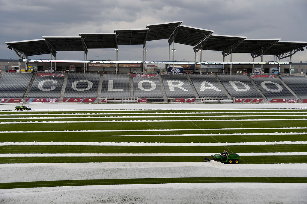 . Grounds crew  hail from the field at Dick\'s Sporting Goods Park. Hail pounded Commerce City blanketing the field at Dick\'s Sporting Goods Park May 21, 2014 where they were about to hold the class 4A soccer finals. (Photo by John Leyba/The Denver Post)